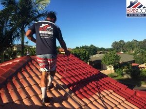 Roof restoration brisbane roof repair roofing painting  1st coat